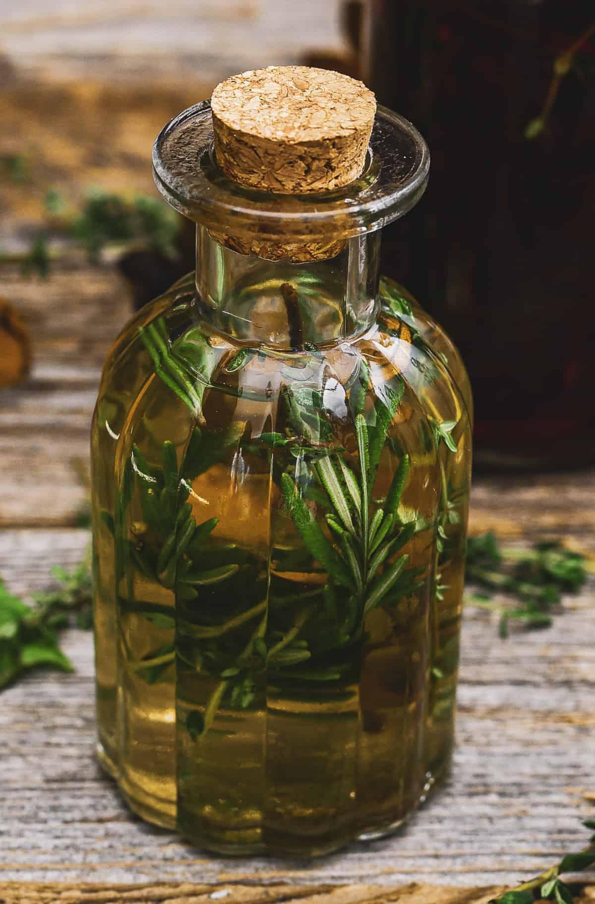 Herb vinegar in small jar.
