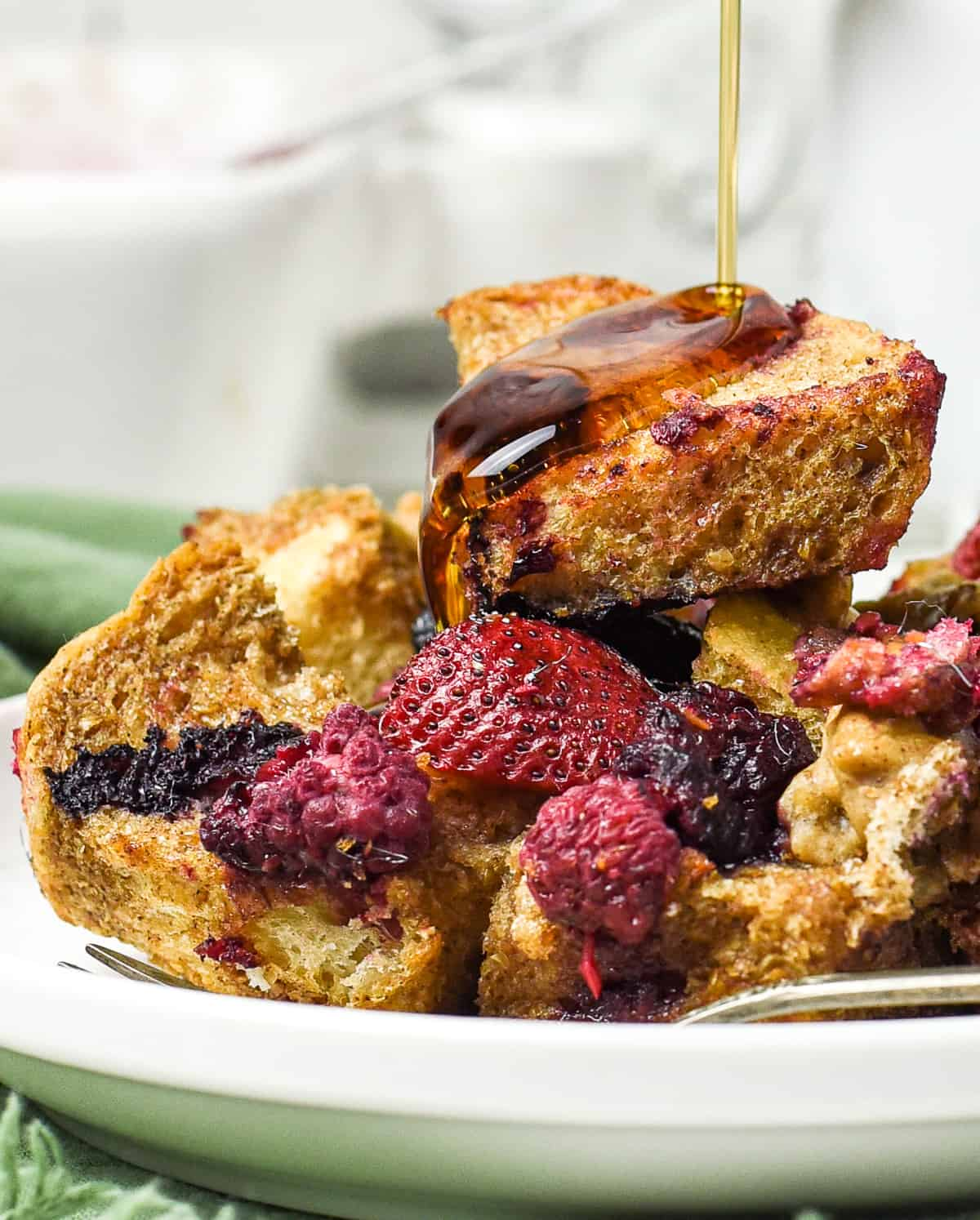 Syrup on top of french toast casserole.