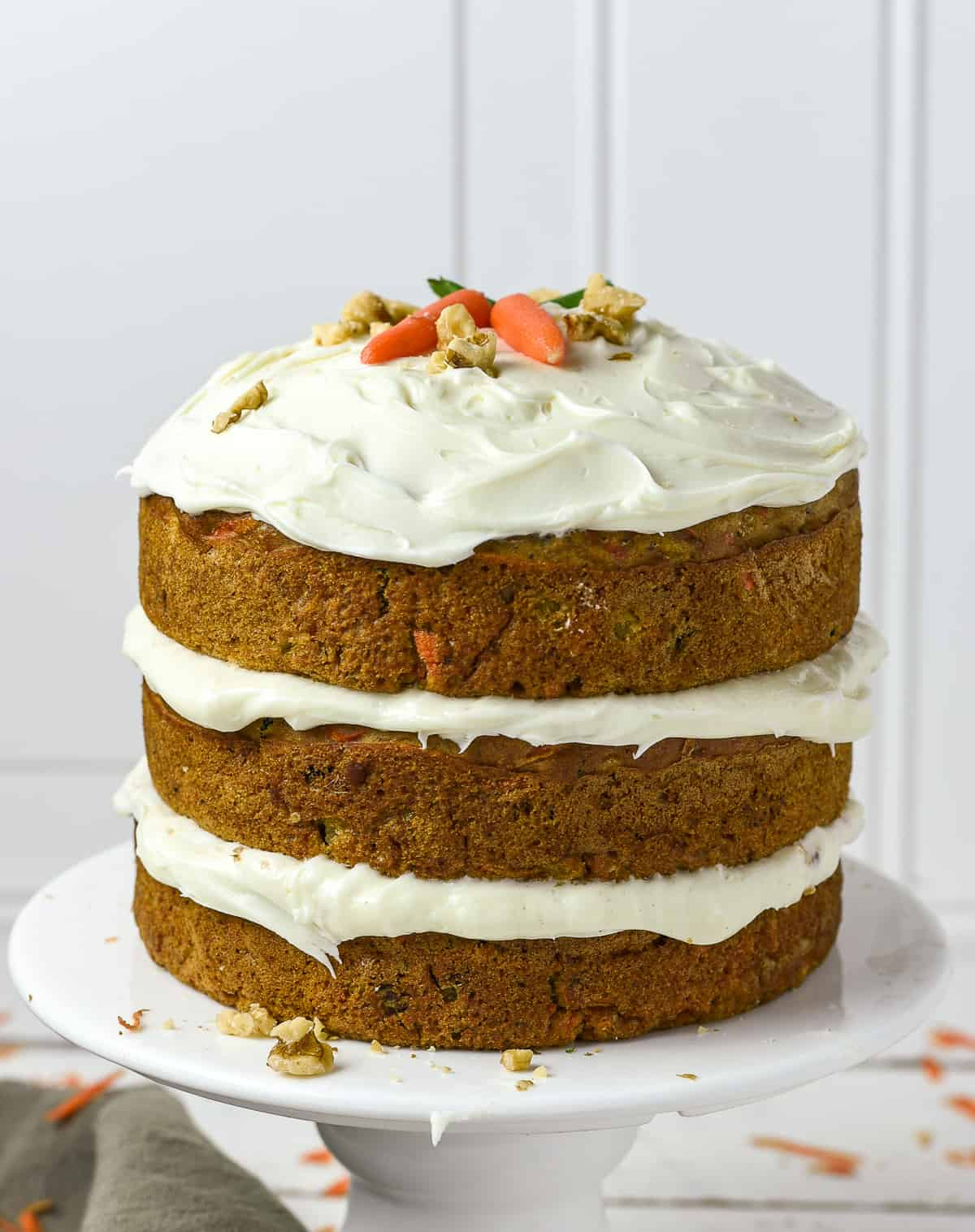 vegan carrot cake with three layers and frosting