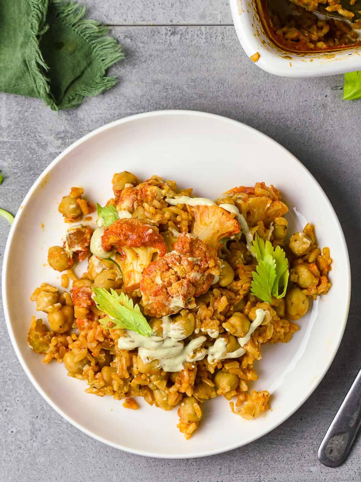 Buffalo chickpea cauliflower casserole on plate.