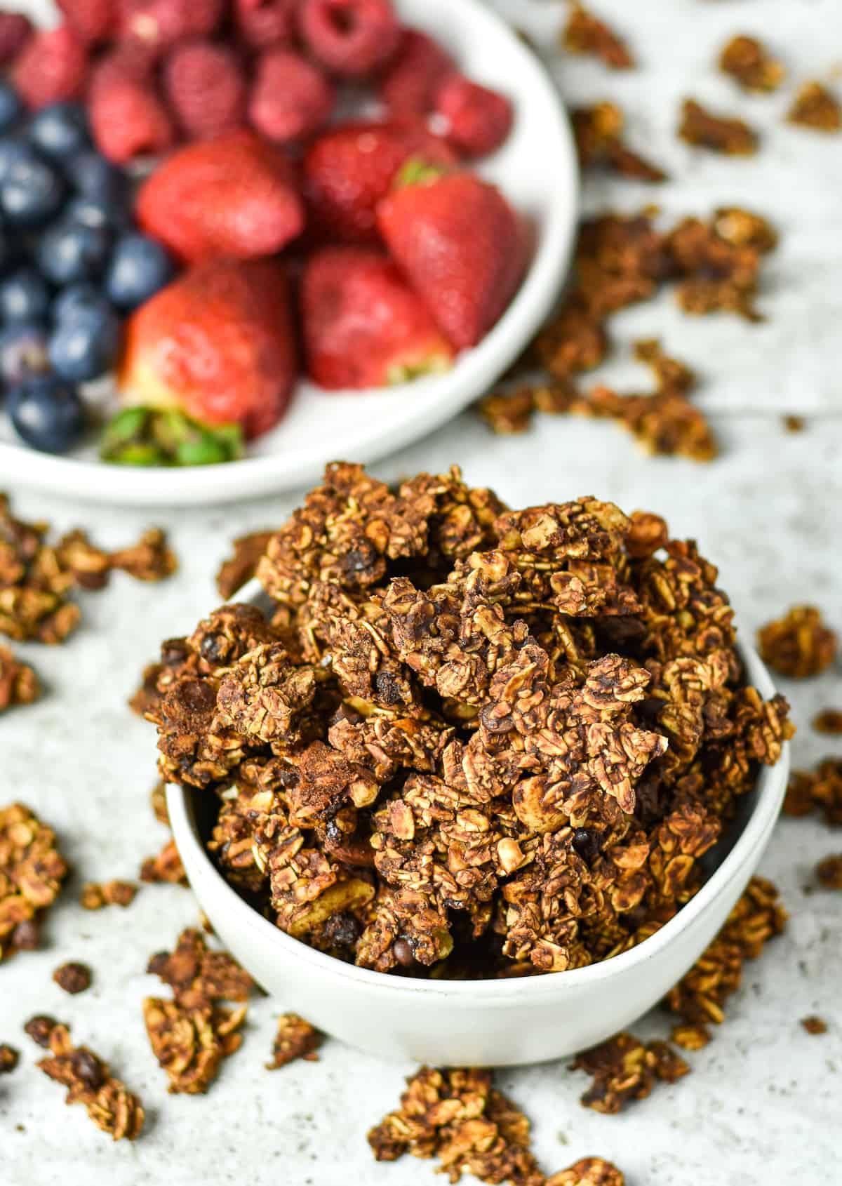 healthy vegan chocolate granola in white bowl.