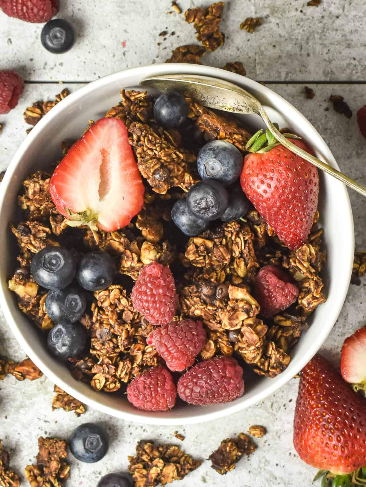 Vegan chocolate granola in bowl with fruit.