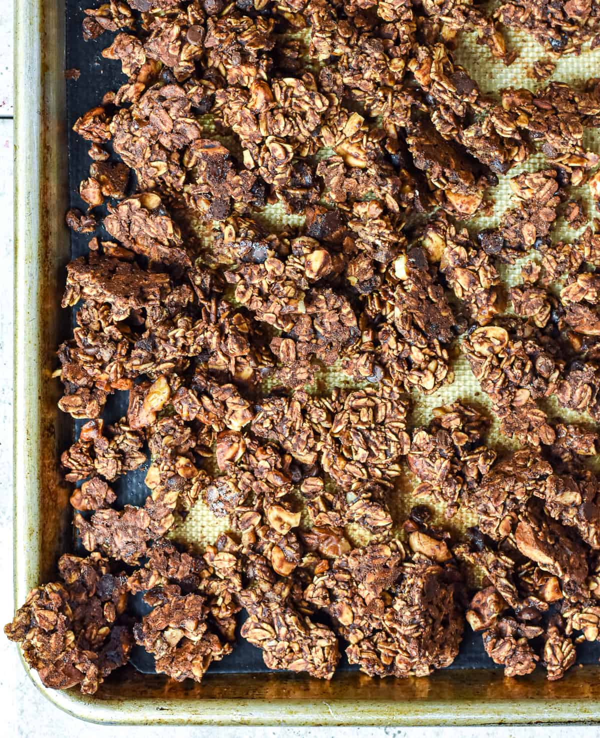 Vegan chocolate granola on baking sheet.
