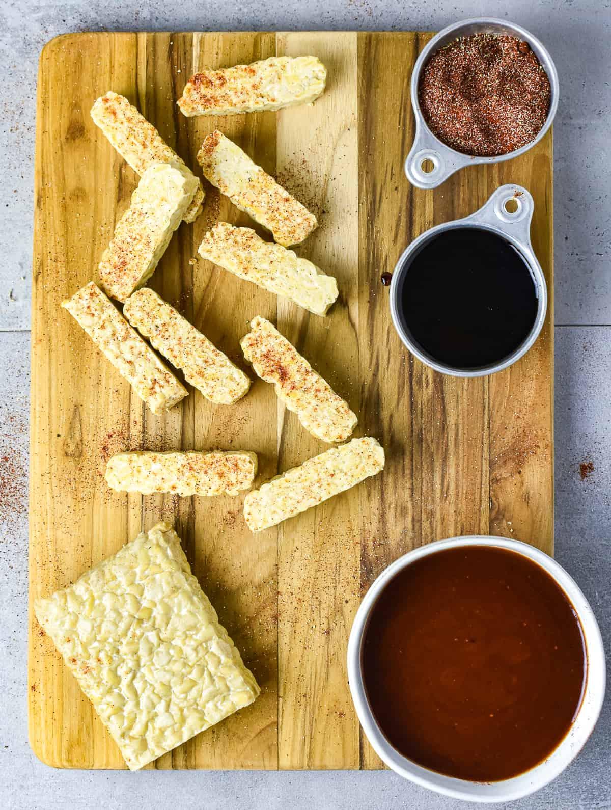 tempeh rib ingredients on cutting board.