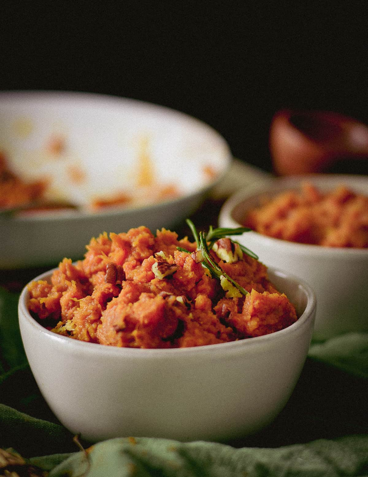 Mashed sweet potatoes in small bowl.