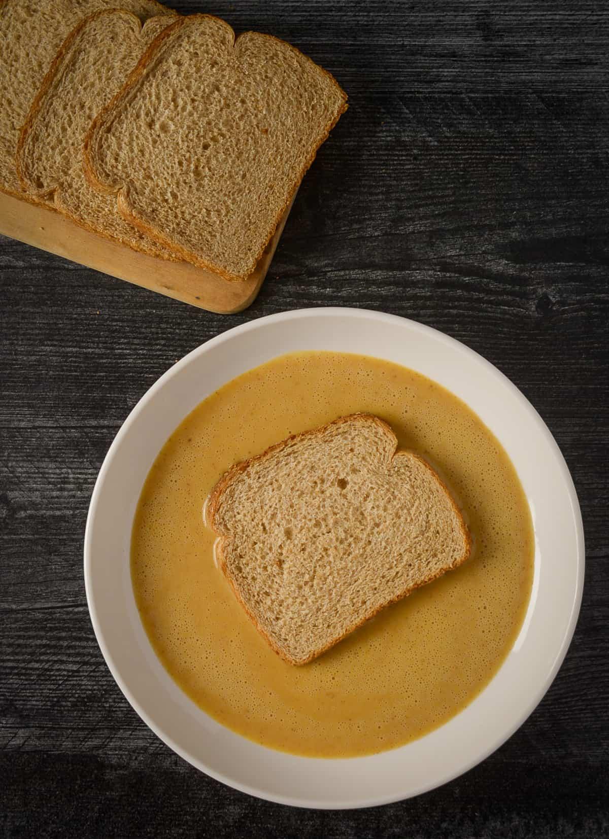 Bread in french toast custard.