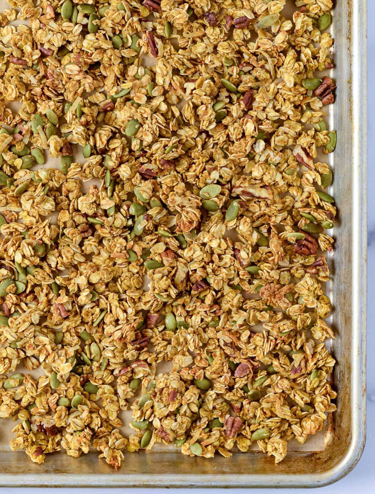 Granola mixture on baking sheet.