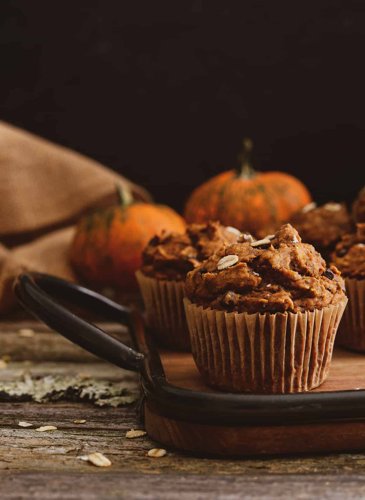 Vegan pumpkin muffin on serving tray.