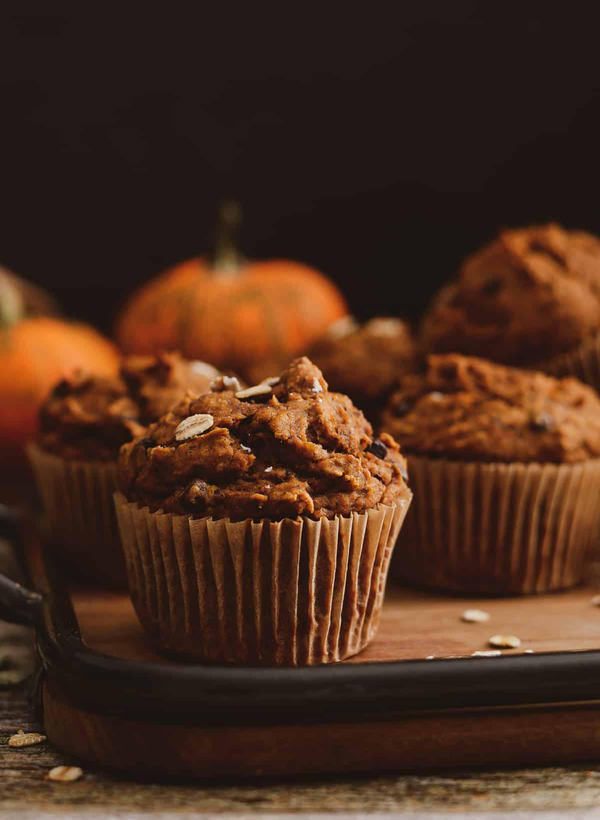 Vegan pumpkin muffins on tray.