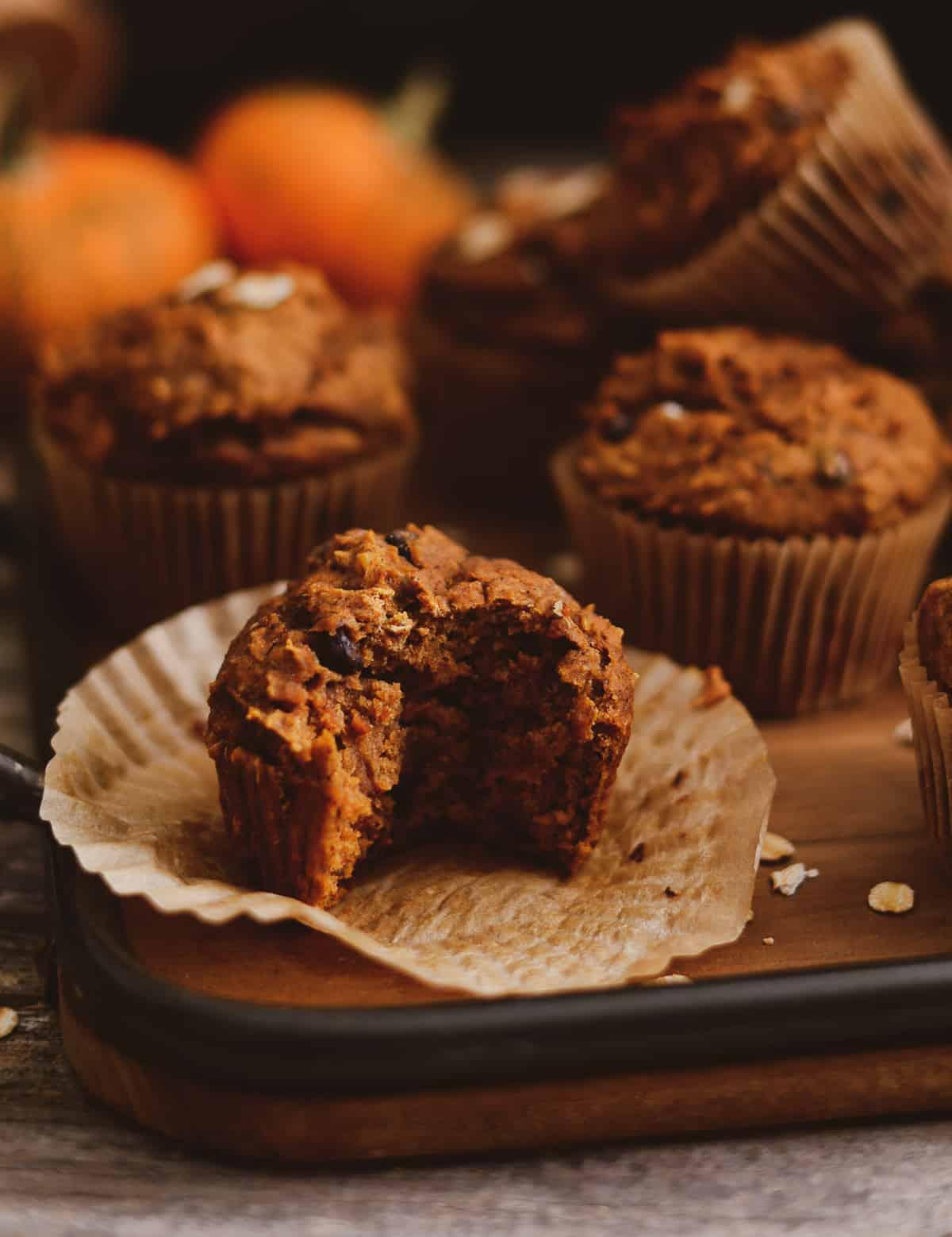 Vegan pumpkin muffin that has been bitten.